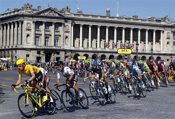 July 22, 2012 Team Sky Procycling rider and leader's yellow jersey Wiggins of Britain cycles during the final 20th stage of the 99th Tour de France cycling race between Rambouillet and Paris