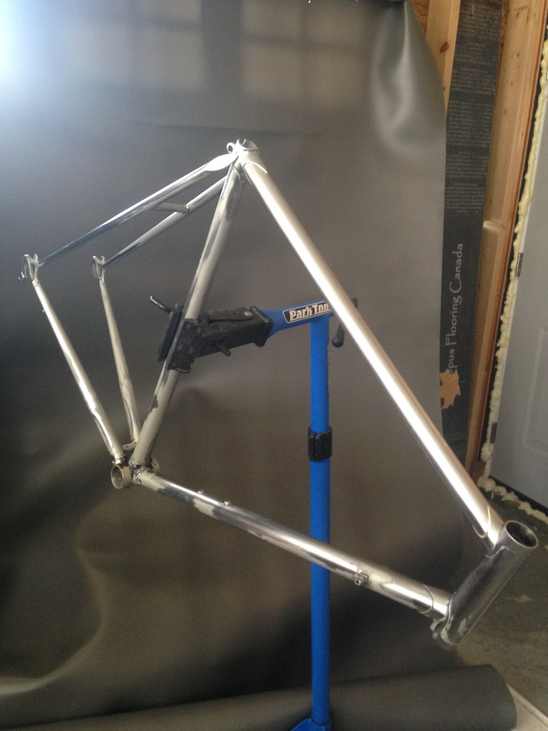 Sanding the bicycle frame